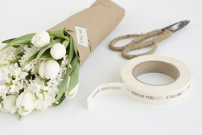 Wrapped white flowers in brown paper packaging